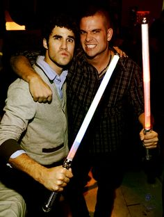 Darren Criss and Mark Salling. I love the looks on their faces. haha