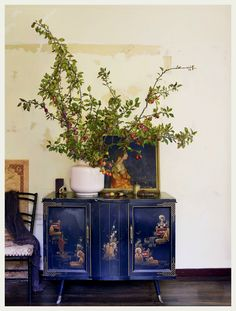 An Indian Summer amazing tablescape of blooming gooseberry on this dark blue cabinet Bohemian love