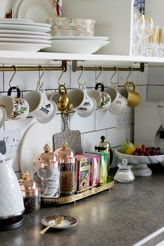 Ruffoni Glass and Copper Jars, plus love the mug racks - see more at www.swoonworthy.co.uk