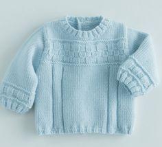 Un mix de point tricot pour ce pull brassière uni. Modèle en laine et alpaga, col rond motif sur les manches et le devant réalisé grâce au point fantaisie.Modèle tricot n°8 du catalogue 85 Layette Bébé.