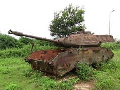 A US tank abandoned in Vietnam. I love the flowers seem to be gently reclaiming it.