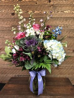 Hydrangea, alstroemeria, rose, stock, hypericum berries, delphinium, waxflower