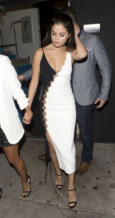 Selena Gomez looking fab in a David Koma Resort 2016 colorblock stunner with an impressive laced-up slit. Behold! http://thestir.cafemom.com/beauty_style/189909/selena_gomez_wears_gorgeous_dress