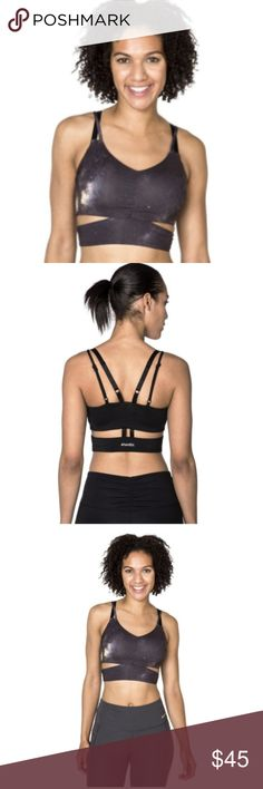 HANDFUL Bound and Determined sports bra Awesome galaxy print, superior support and quality and stylish details will make this Handful sports bra your favorite! Brand new with tags in original packaging. Size M, fits sizes 36-38 A to C cups. Handful Tops