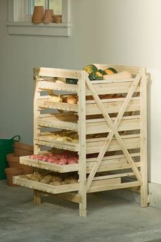 Orchard rack for storing vegetables~ Gardener's Supply Company sells a 6 drawer and a 9 drawer