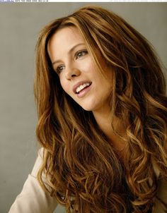 Pictures of celebrities with dark brown hair and blonde highlights. Kate Beckinsdale, Megan Fox, Penelope Cruz, and Kourtney and Khloe Kardashian. Use these photos for for your mane inspiration!