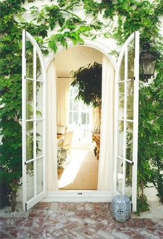 Arched french doors ...vine covered walls! http://cococozy.com