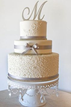 You could make your cake even more beautiful with creative wedding cake toppers. There are many ideas to consider for rustic to modern wedding theme. See more http://www.weddingforward.com/wedding-cake-topper-ideas-inspiration/ #weddingcaketoppers  #weddingcake #weddingtheme