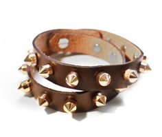 "This brown leather studded bracelet for ONLY $35.00!  Studded Leather Wrap Bracelet.  Espresso brown leather, gold-colored metal studs.  Stud closure with holes for sizing. 17"" length.  @ www.facebook.com/studio24e"