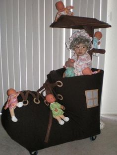 """Homemade """"old Lady Who Lived in a Shoe halloween Costume for kids. Looks like they used the stroller as the base. Homemade Toddler Costumes, Homemade Halloween Costumes, Cute Costumes, Halloween Costumes For Girls, Baby Costumes, Costume Ideas, Halloween Treats, Cosplay Costumes, Halloween Infantil"""