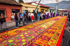 """""""Lavish Semana Santa (Holy Week) in Antigua, Guatemala features elaborate floats passing over (and destroying) intricate carpets of colorful flowers & colored sawdust in a huge passion play throughout the entire city. Holy Week Activities, Celebration Around The World, Guatemala City, Lake Atitlan, Beautiful Streets, Beautiful Gardens, Easter Traditions, Travel Tours, Travel 2017"""