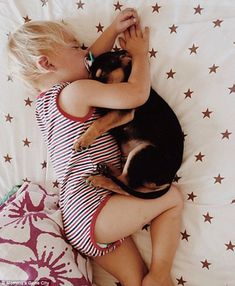 Dog tired! Adorable toddler and his 'puppy brother' Theo who nap together every day