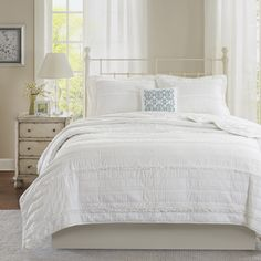 Isabella a shabby chic look in your bedroom with the Madison Park Celeste Collection. This solid white coverlet has ruffles and quilting paired with a contrasting embroidered decorative pillow for a clean update for your space.