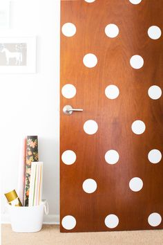 Add vinyl polka dots to a door for a fun and playful look. Cute for a kid's room or even an office and so perfect for dorm rooms or rental apartments.