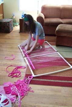 Make a rug loom with PVC pipe.   Weave around top/bottom and sides of PVC to keep the weaving from pulling in.  When done, just take apart the PVC and slip off the rug.   What a great idea from Pink In Mind.