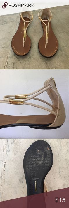 Authentic Dolce Vita Used Sandals Cream colored and gold accented with a brown sole. Definitely used with scuffs on back and bottom. Dolce Vita design on bottomed is worn off. But really great sandal. Still in good shape other than the scuffs! Dolce Vita Shoes Sandals