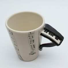 I want all these music mugs! Piano one is my fav :)