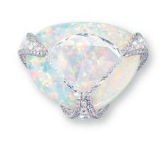 A Diamond and White Opal Ring  Centering upon a shield-shaped rose-cut diamond weighing approximately 5.36 carats, overlapping a triangular-shaped white opal, joined by circular and oval-shaped rose-cut diamond openwork prongs with brilliant-cut diamond trim, mounted in 18k white gold
