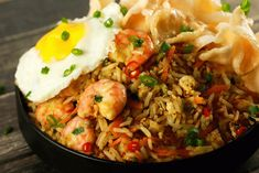 Spicy Indonesian Fried Rice Shrimp Nasi Goreng - Make this delicious spicy Indonesian fried rice in 15 minutes and amaze all your friends and family! It's literally bursting with flavors and is SO simple to make! It doesn't get better than this!!   ScrambledChefs.com