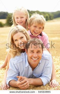 stock photo : Family Relaxing In Summer Harvested Field