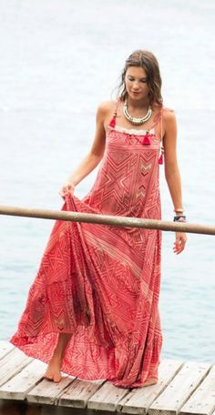 Stunning boho maxi paired with a bold statement piece.