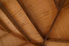In typical lumber-frame construction, roof insulation is placed between rafters and then covered up with drywall. When the rafters are exposed, such as in timber-frame houses, this technique is not . Exposed Trusses, Exposed Beams, Roof Beam, Roof Trusses, Wood Ceilings, Ceiling Beams, House Ceiling, Open Ceiling, Vaulted Ceilings