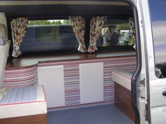VW Camper T5 with lovely stripey interior cabinets seen at Bus Types VW Show 2014.