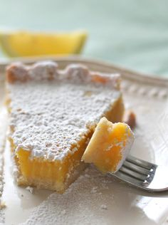Lemon Tart with Shortbread Crust is the dessert of this season!Fresh and lemony,rich and decadent with a buttery shortbread crust, its all you need to satisfy your sweet cravings! #lemontart #lemondesserts #springdesserts #tart #dessert #shortbreadcrust #deliciousness #baking #easydessertideas #homemade
