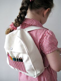 red gingham backpack with mini pencils