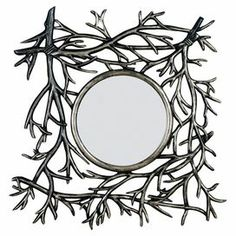 42a344b5b241 Round wall mirror with a bramble-inspired frame in silver-tinged dark  walnut.