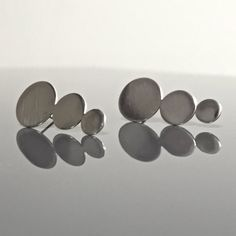 GRADUATED circle earrings brushed silver disc post by MetalObjects