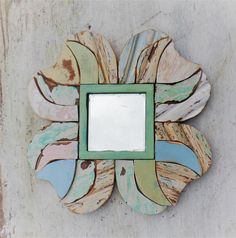 I framed this mirror with pieces of reclaimed wood. I used blues,, greens and pink. Can hang 8 big ways!!! Mirror is a 6 inch square. whole piece is 19x19 inches. more mirrors: https://www.etsy.com/shop/woodenaht?section_id=13822651&ref=shopsection_leftnav_9