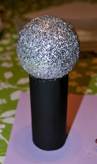 What preschooler doesn't like to sing at the top of their lungs? Help them make their own microphone and rock out together.