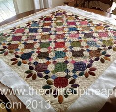 Beautiful quilting on a fun, primative quilt from Simple Charm by Kim Diehl.