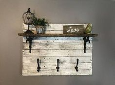 Discover thousands of images about White distressed shelf entryway shelf mudroom shelf Pallet Wall Decor, Pallet Wall Shelves, Rustic Shelves, Shelf Wall, Room Shelves, Mudroom Shelf, Entryway Shelf, Entryway Organization, Diy Pallet Projects