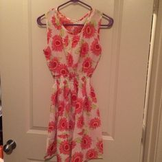 Pink floral dress! The tag says it's a size large and although it stretches in the middle, I would say it runs more like a medium. Great condition Liva Girl Dresses