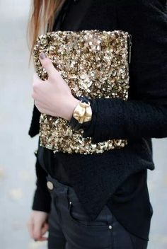{ gold clutch on all black }