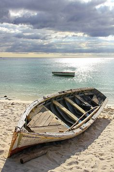Mauritius - old battered boat on the beach 9 by Romeodesign, via Flickr