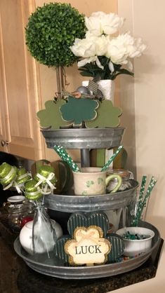 Decorated St. Patrick's Day 3 tiered stand St Patrick's Day Decorations, Holiday Centerpieces, St Patrick Decorations, 3 Tier Stand, Tiered Stand, St Paddys Day, St Patricks Day, Saint Patricks, Galvanized Tiered Tray