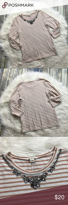 """J. Crew Factory Striped Jeweled Necklace Tee Tan and white striped 3/4 sleeve t-shirt. Jeweled neckline - so pretty! However, please see close up photo of jeweled neckline as there is one stone missing near the middle. The rest of them are in tact and the shirt is otherwise gently used and in good condition.   Measurements laying flat (without stretching): --Armpit to armpit:17.5""""  --Length, shoulder to hem:24.5"""" J. Crew Factory Tops"""