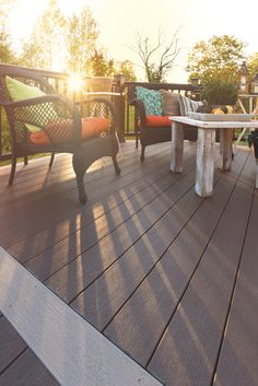 You will always enjoy the view of the sunset or sunrise on your TimberTech Deck. This deck is from our Terrain Collection in Rustic Elm. Metal Barn Homes, Pole Barn Homes, Porches, Timbertech Decking, Log Homes Exterior, Plastic Decking, Deck Seating, Deck Colors, Pole Barn House Plans
