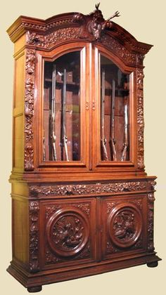 19th Century Carved Oak Gun Cabinet