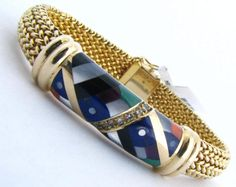 An Asch Grossbardt 14K yellow gold bracelet with diamonds and inlaid with lapis, malachite, mother of pearl, onyx, and coral #AschGrossbardt