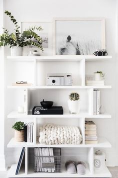 Add the modern decor touch to your home interior design project! This Scandinavi… Add the modern decor touch to your home interior design project! This Scandinavian home decor might just be what your home decor ideas is needing right now! Pin: 650 x 975 White Shelves, White Shelving Unit, Shelving Units, Minimalist Decor, Minimalist Kitchen, Minimalist Living, Bedroom Ideas Minimalist, Minimalist Baker, Minimalist Shelving
