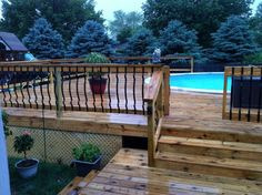 A mix wooden and steel post and rail pool fence. Source: troublefreepool.com