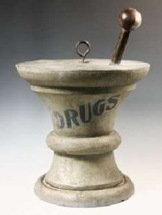 19th century apothecary trade sign in the form of mortar and pestle ...