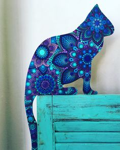 Blue and purple dot cat...