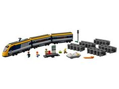 LEGO City Trains - Passenger Train and thousands more of the very best toys at Fat Brain Toys. Build a big motorized passenger train, a full-circle train track, and a small train station! The two passenger cars feature opening. Lego City Train, Lego City Sets, Lego Trains, Lego Sets, Locomotive, Boutique Lego, Chateau Disney, Modele Lego, Lego City