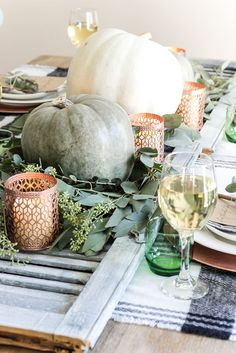 Green and Copper Thanksgiving Tablescape + Printable | http://blesserhouse.com - Spray paint dollar store votives with copper, use scarves as a tablecloth, and an old shutter as a runner! So cheap and easy!