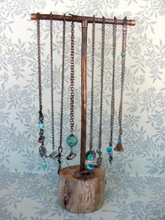 Salvaged driftwood and recycled copper jewelry display